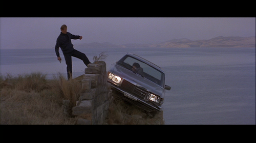 Roger Moore is James Bond in For Your Eyes Only kicking Locque's car off cliff