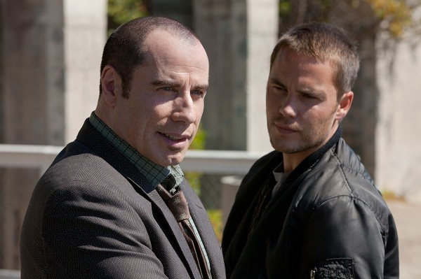 John Travolta and Taylor Kitsch in Savages