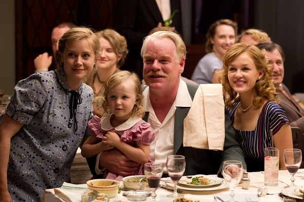 Amy Adams, Lorelai Hoey, Philip Seymour Hoffman, and Ambyr Childers in The Master
