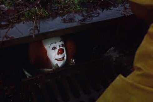 Tim Curry as Pennywise the Clown in Stephen King's IT