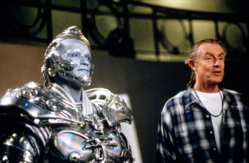 An evil supervillain intent on destroying Batman for good, standing next to Arnold Schwarzenegger