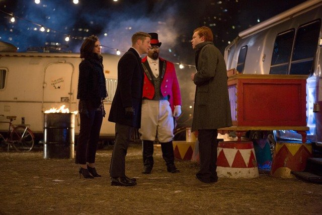 """GOTHAM: After the circus comes under attack, Detective James Gordon (Ben McKenzie, second from L) and Dr. Leslie Thompkins (guest star Morena Baccarin) question the son (guest star Cameron Monaghan, R) of a circus performer in the """"The Blind Fortune Teller"""" episode of GOTHAM airing Monday, Feb. 16 (8:00-9:00 PM ET/PT) on FOX. Also pictured: guest star James Monroe Inglehart, second from R. ©2015 Fox Broadcasting Co. Cr: Jessica Miglio/FOX"""
