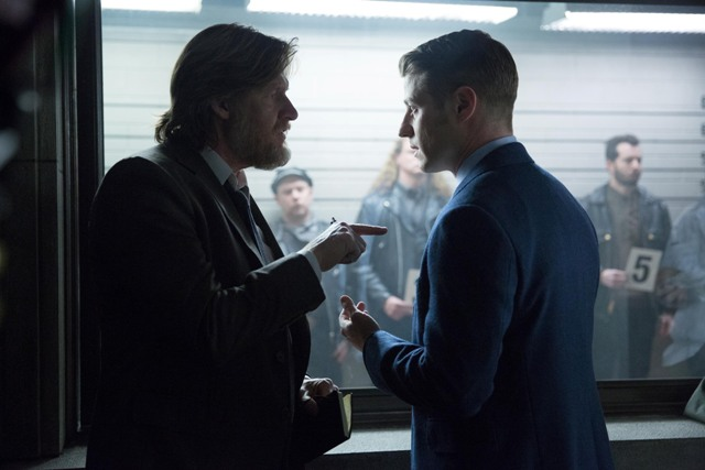"""GOTHAM:  Gordon (Ben McKenzie, R) and Bullock (Donal Logue, L) participate in a police line-up in the """"Red Hood"""" episode of GOTHAM airing Monday, Feb. 23 (8:00-9:00 PM ET/PT) on FOX.  ©2015 Fox Broadcasting Co.  Cr:  Jessica Miglio/FOX"""