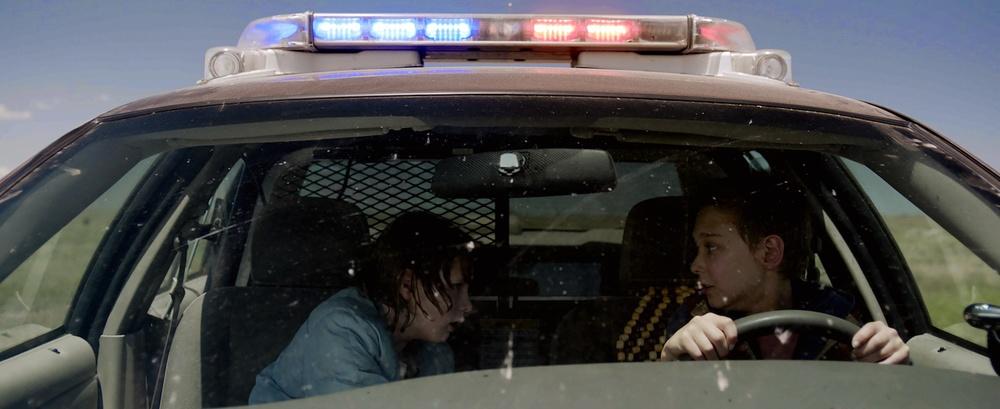 two-kids-take-a-traumatic-joy-ride-in-cop-car-sundance-2015-review