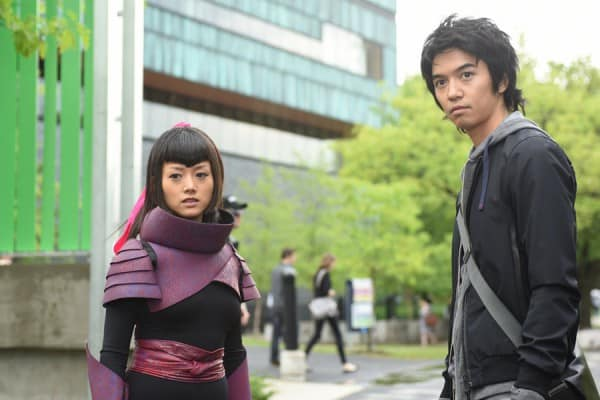 Miko and Ren stand outside Renautas