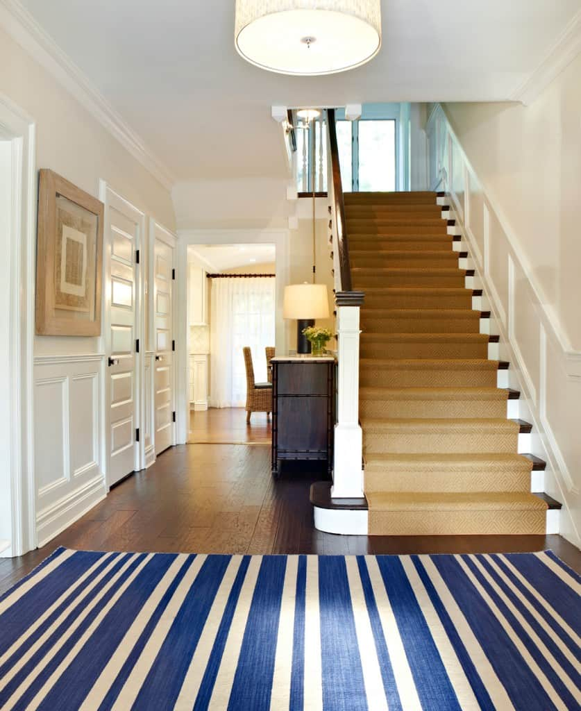 Bold blue in the rug pairs well with light brown textiles on the stairs and the white walls. This is a great way to add a pop of color to an otherwise neutral home's color palette.
