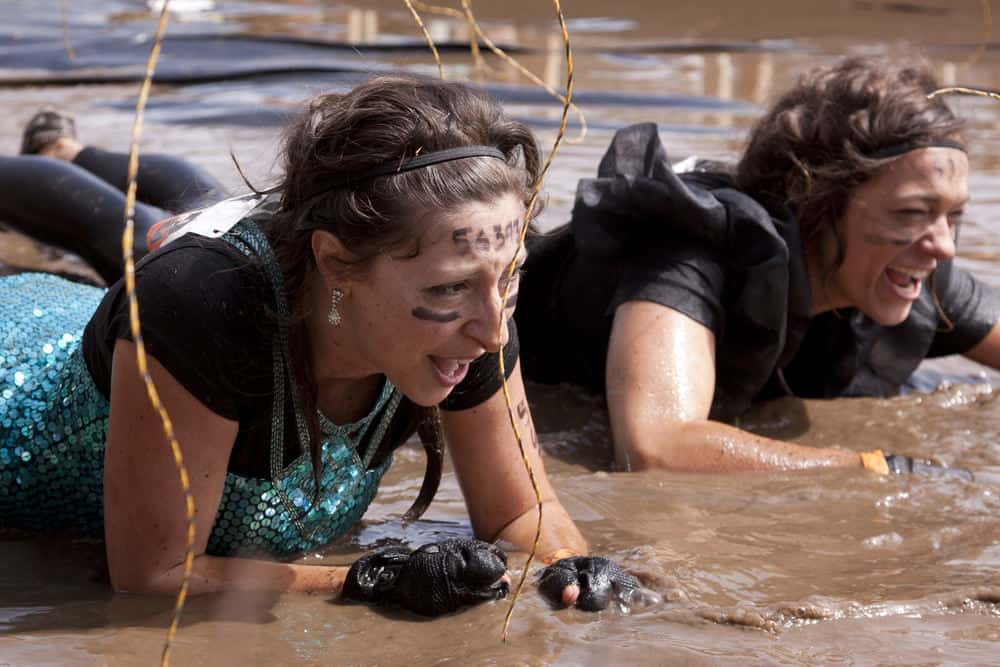 Women crawling through mud