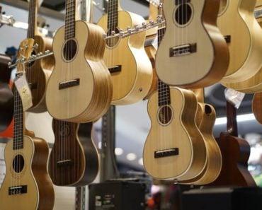 Wooden acoustic guitars.
