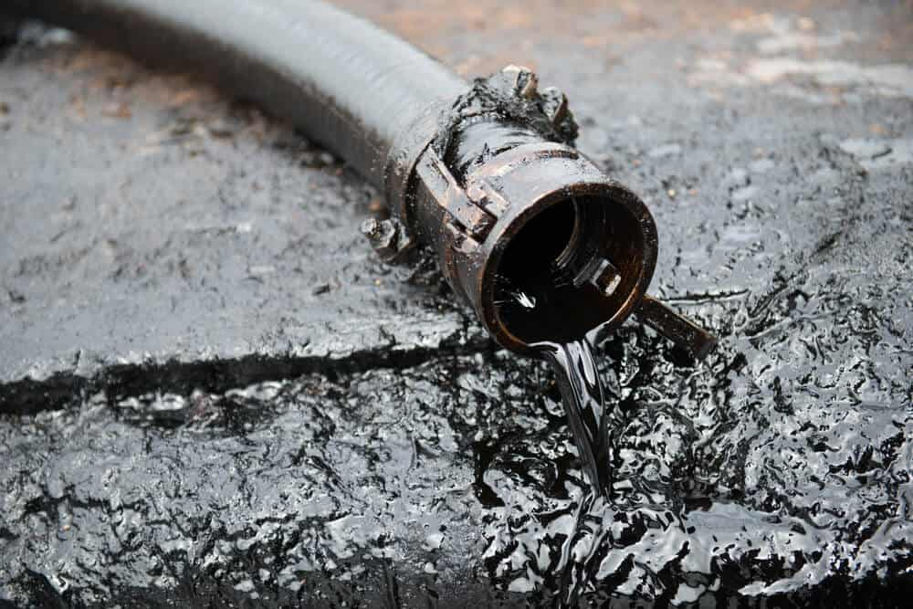 Crude oil flowing from a hose.