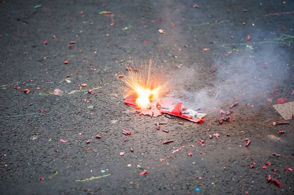 Firecrackers exploding at the ground.