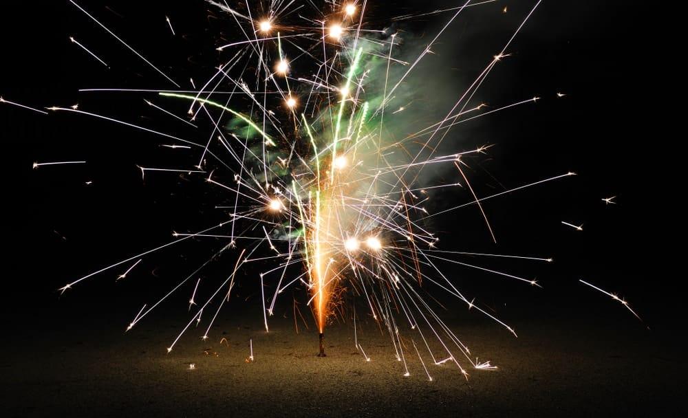 Fountain firework exploding on the ground.