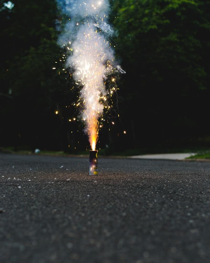 Novelty cake firework exploding on the ground.