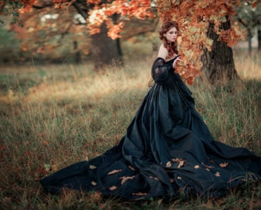 A woman wearing a Gothic gown.