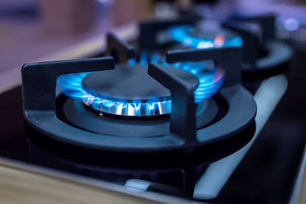 NAtural gas of a stove with a blue flame.