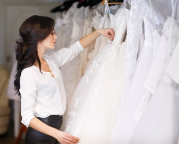 Woman choosing wedding dress.