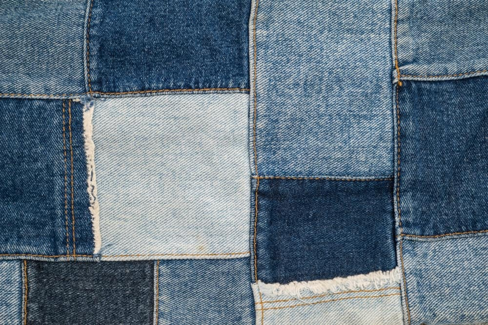 A patchwork of denim fabric.