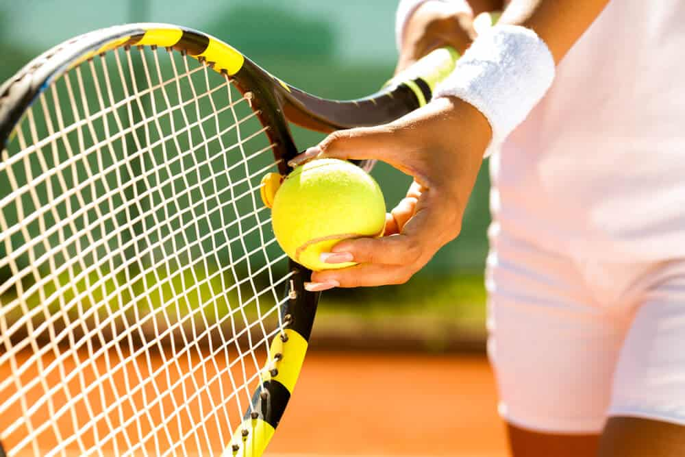A closer shot at the main tennis equipment during a tennis game.