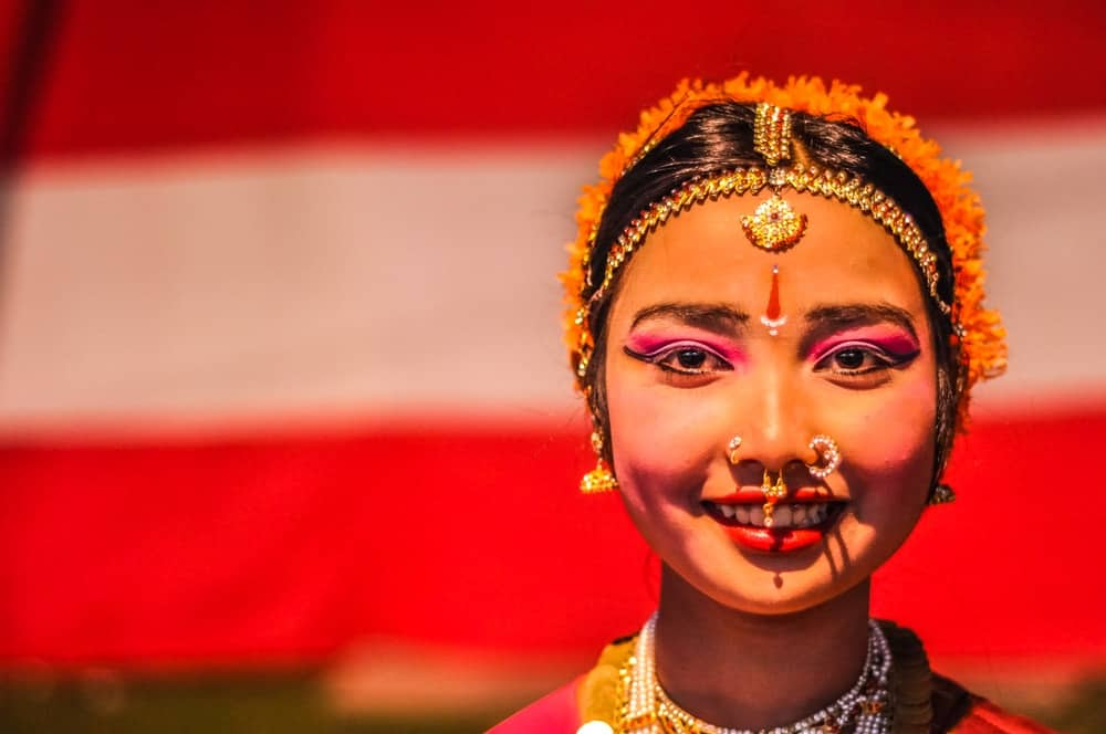 Beautiful young woman with piercings in her nose and pink eyeshadows during performance at Bihu festival in Guwahati, Assam.