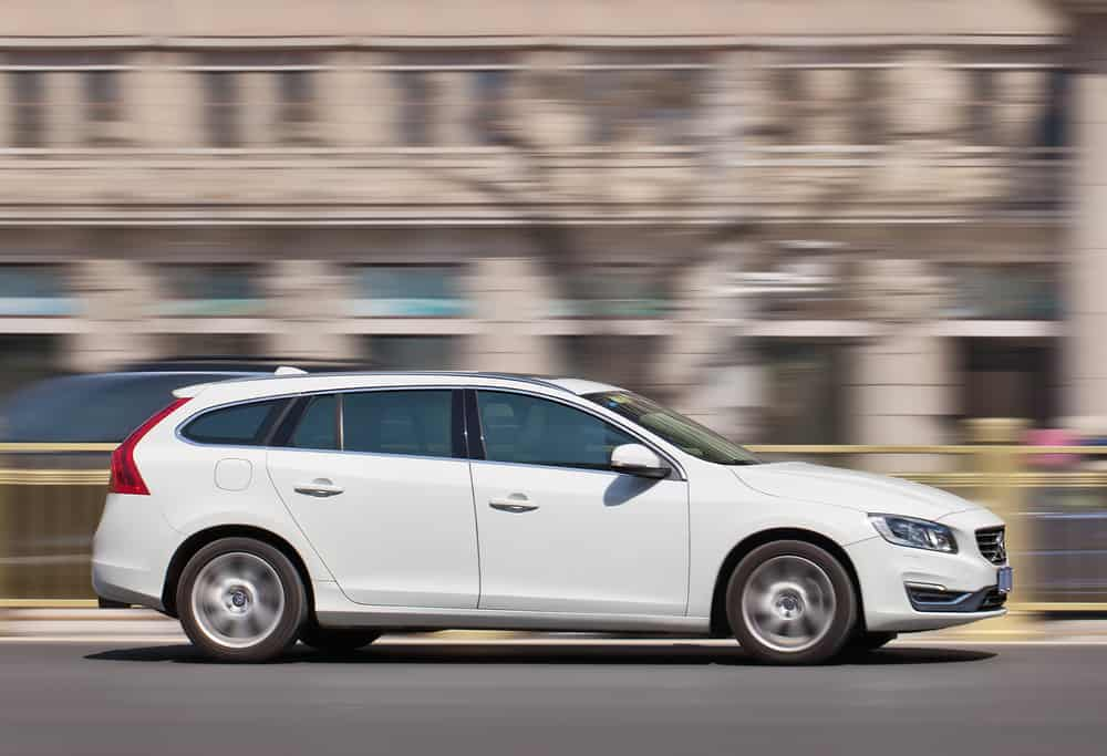 White Volvo V60 station car.