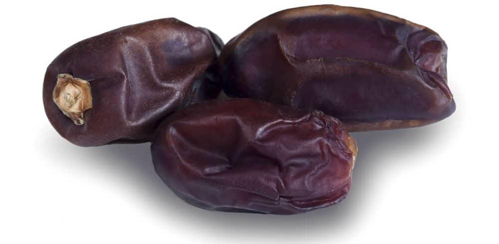 Three pieces of Khudri dates.