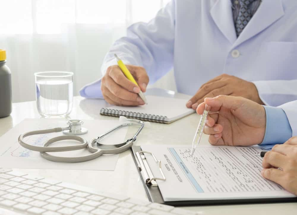 A doctor is preparing his clinical case study article with his colleague.