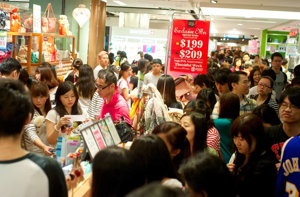 Discount consumers flock a shopping sale in a mall.