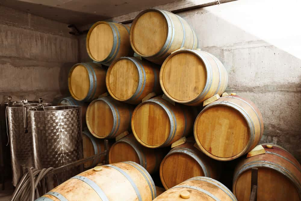 Barrels of fermented wine and alcohol.