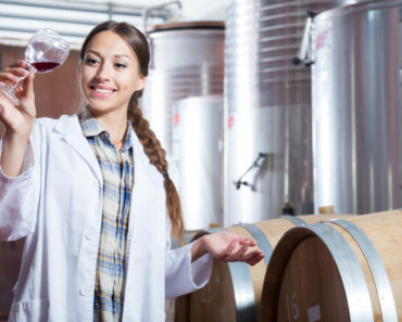 A woman keenly observing the product of their fermentation.