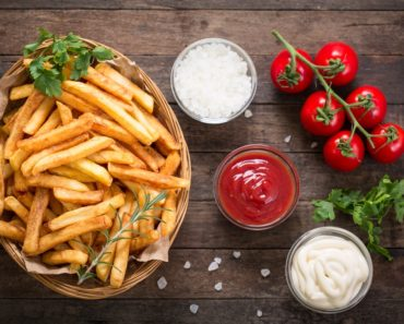 French fries served with condiments on the side.