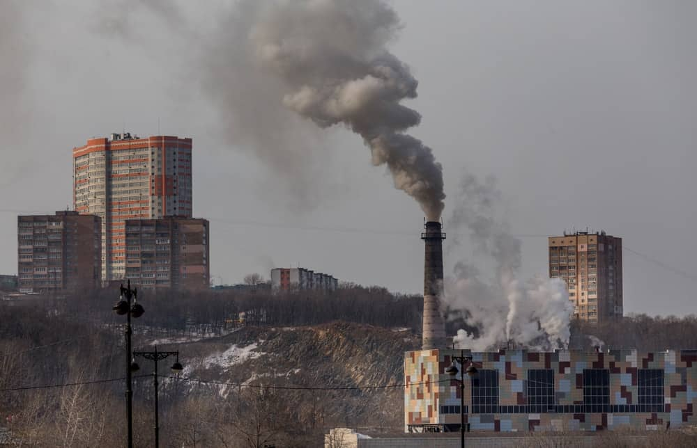 Industrial factories emit greenhouse gases that pollute the air.