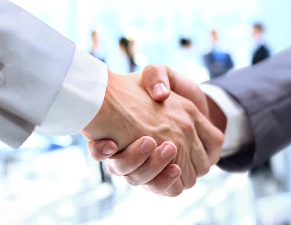 Men of different parties, shaking hands.