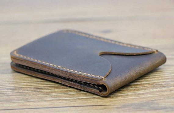 An ID wallet made of dark brown leather.