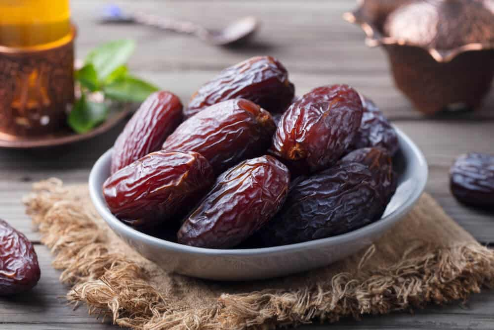 Medjool dates in a small-sized gray bowl.