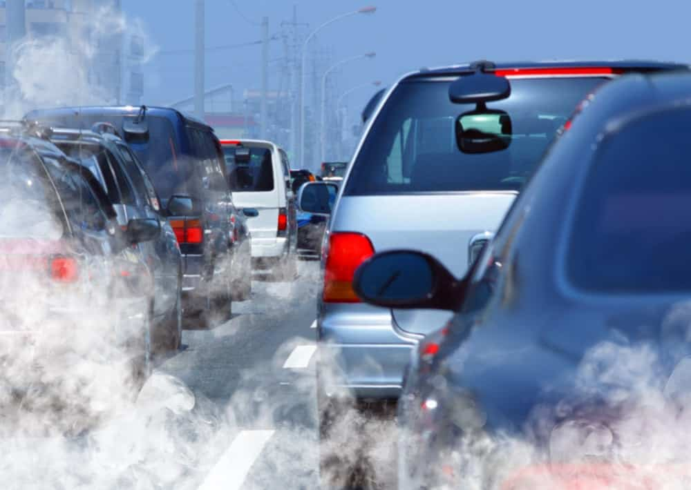 A traffic jam of cars that emit harmful gases, thereby polluting the air.