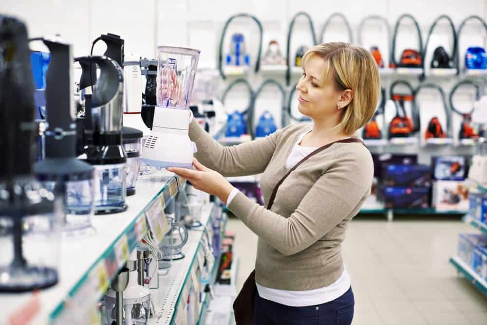 A lady is shopping for personal household items.
