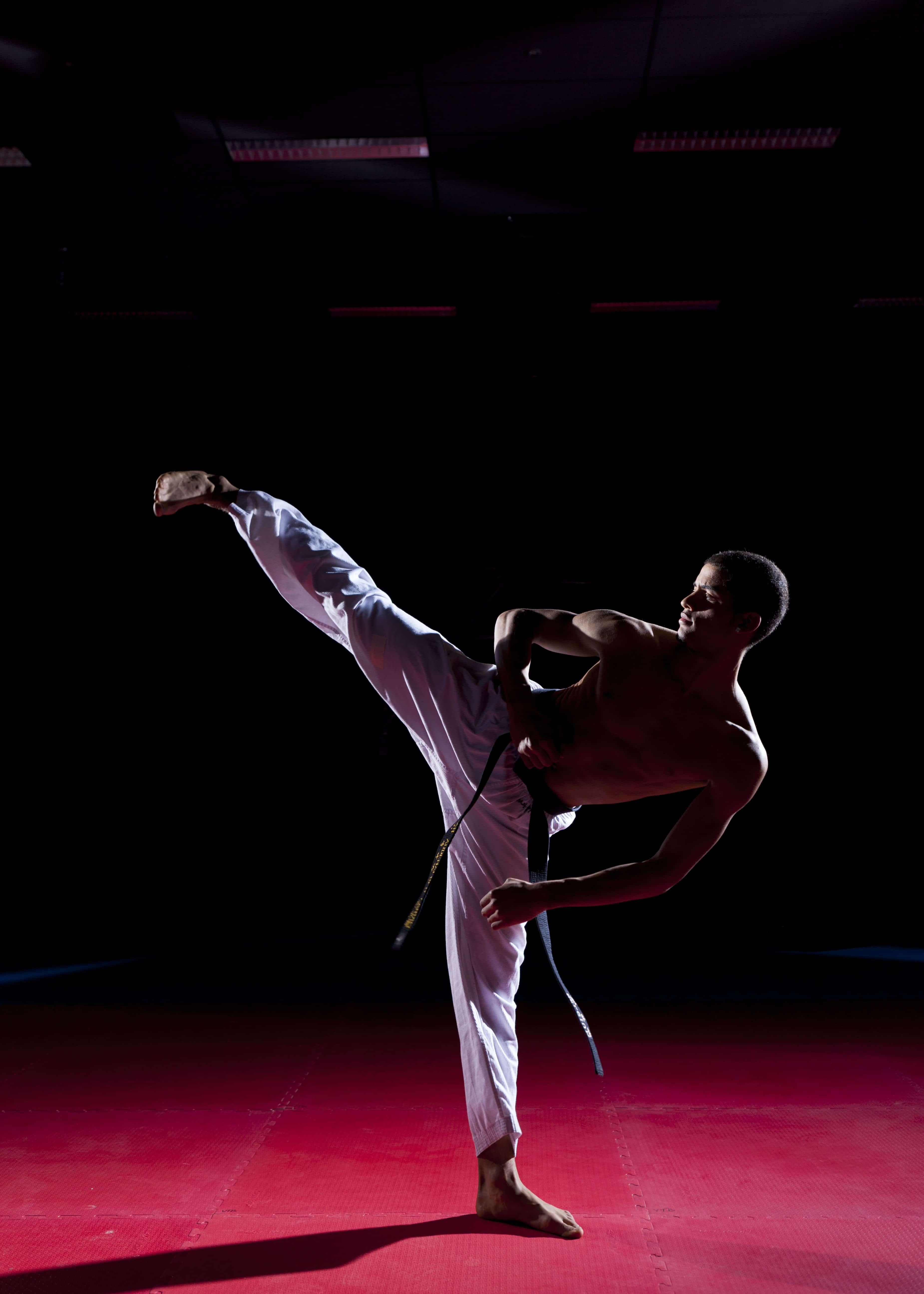 A martial arts teacher demonstrates how the side kick is done.