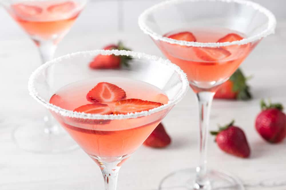Three servings of homemade strawberry martinis.