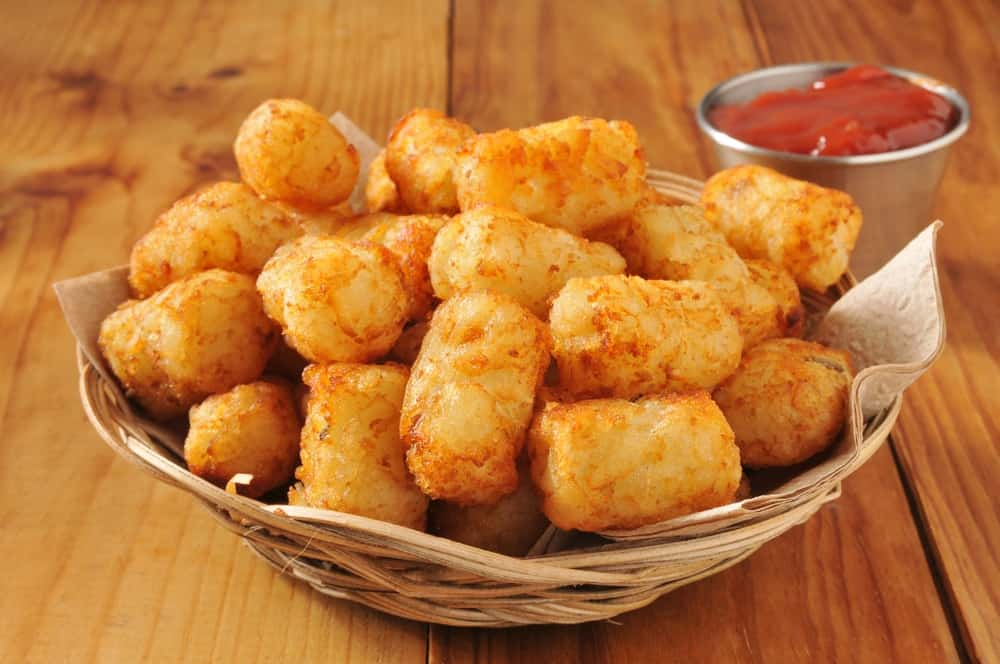 Tater tots served on a basket.