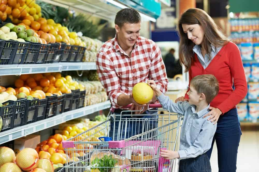 A family is shopping for grocery items.