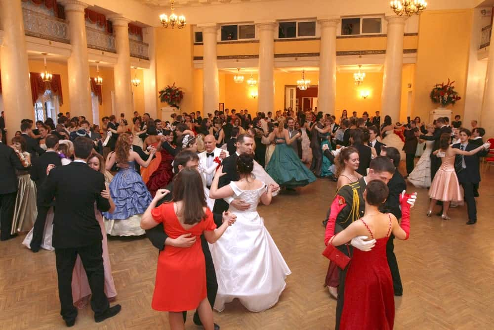 Members of the aristocracy participate in a ball.