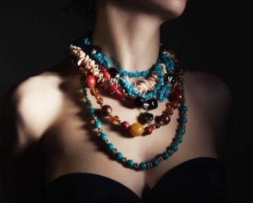 A woman wearing a multi-colored bead necklace.