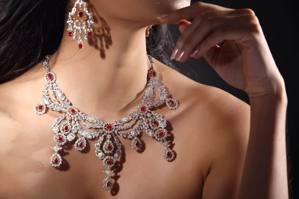 A woman wearing a diamond bib necklace.