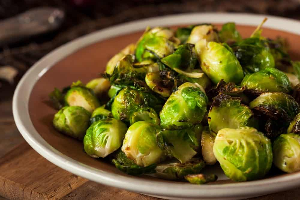 A bowl of roasted brussel sprouts.
