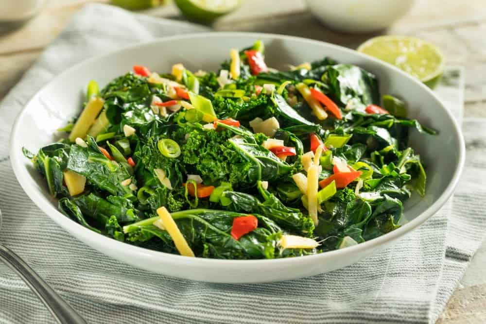 A bowl of collard greens salad.
