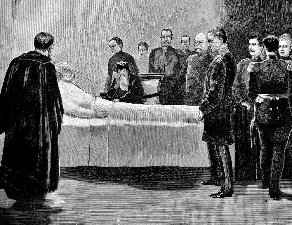 Black and white deathbed scene of an old man lying in bed and surrounded by men in different uniforms.