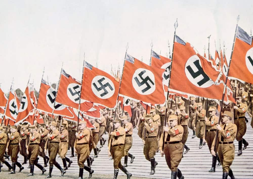 Flagbearers bearing the symbol of the Nazi Germany.