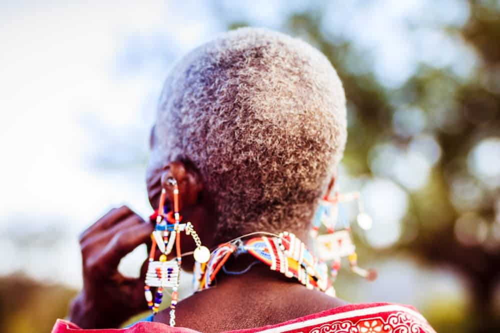 Back view of an ethnic woman with colorful large earrings.