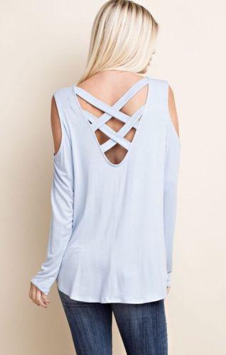 Light blue top with a criss-cross back design.