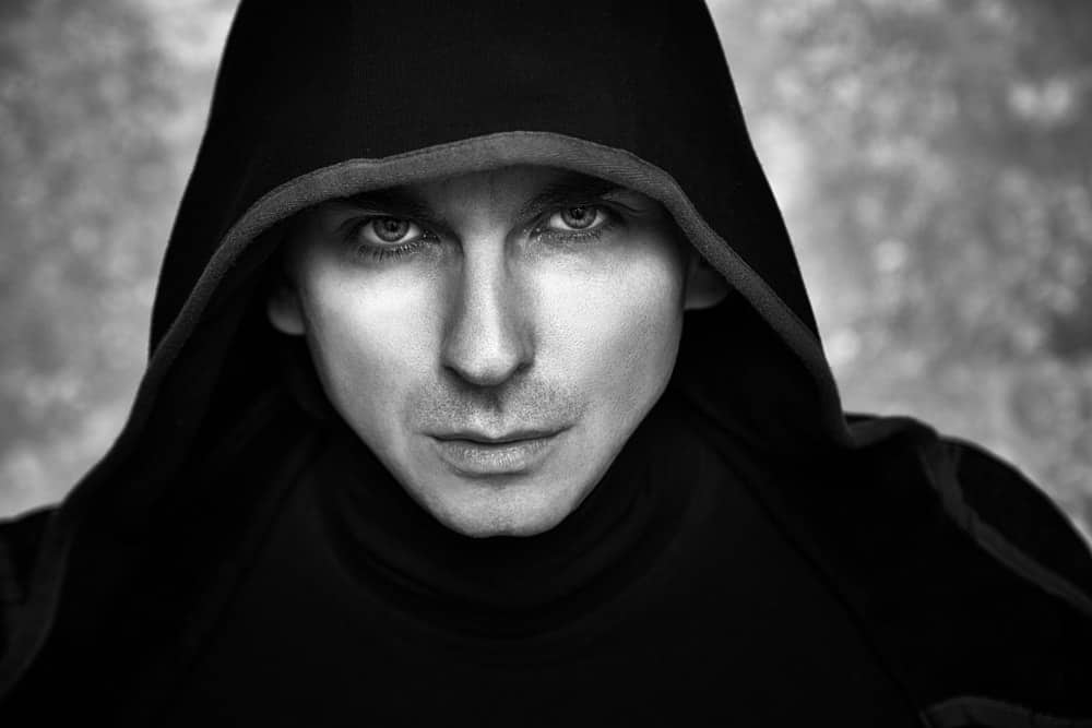 A male mage who is cloaked in black.