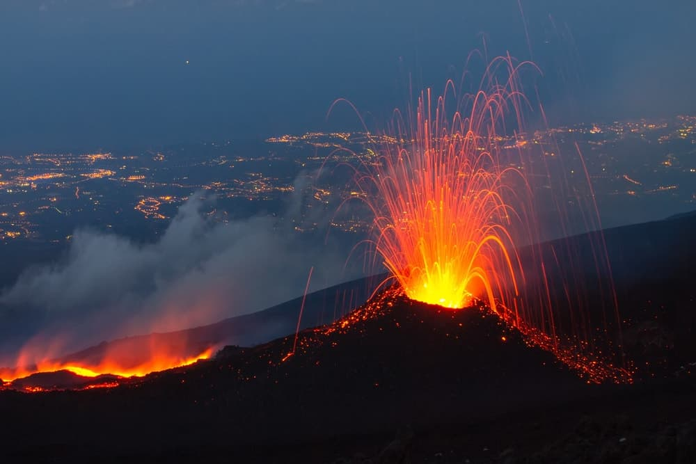 Magma as it shoots out of the crater of a volcano.